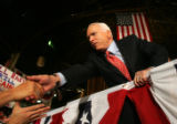 (CS512) Republican presidential candidate John McCain shakes hands with supporters at the National...