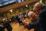 (from left) 82 year-olds Jack Pepler (cq) and her wife of 61 years, Elanor Pepler (cq) dance to...