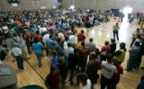 BG0240 More than a thousand gather for a town meeting to inform the public about the affected area...
