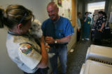 MJM996  Weld County animal control officer, Debbie O'Connor (cq), left, is reluctant to part with...