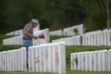 88 year-old Paul Blateric (cq) walks through several rows of headstones, on his way to visit his...