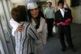 MJM162   Alex Rodriguez (cq) welcomes her aunt, Ida Gonzalez (cq) before her graduation as the...