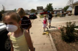 ({seqn)} Chloe King, 9, walks around with her brothers, Gaige King, 11, (second from left) and...