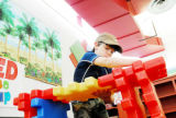 Reid Killebrew, 8, of Longmont, works on fitting pieces together while building a structure May 6...