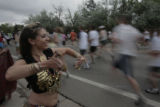 "Dancer Abby Barreto (cq), "" Amanya"", entertains runners  on Folsom Rd, Monday morning,..."