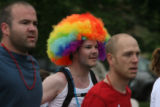 A runner wears a colorful wig as he head up Folsom Rd, Monday morning, May 26, 2008,at the Bolder...