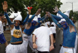 DM1880  Dressed as Smurfs Ashlee Vblez, left, and Brent Abbott, right,  and their friends make a...