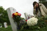 MJM152  JoAnn Trembly (cq), of Colorado Springs, Colo. wipes away tears as she visits the grave of...