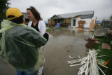 Sheila Bowman cries and is comforted by Kathy Brush (cq) with disaster relief  in Windsor, Colo....