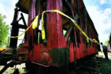 Several vintage railroad cars that were being restored were found to be on fire.  One was engulfed...