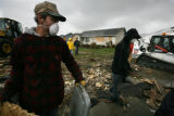 Mark Hanson, with the Calvary Chapel of Greeley came with his family to make mountains of debris...