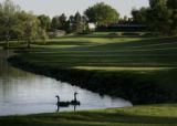 The water hazard on the 18th hole creeps into the  fairway of Cherry Hills Country Club Golf...