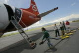 DM0216  Janice Naylor drags the hose over to Tanker 25 operated by Aero Union to fill it with fire...