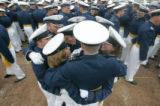 A group of cadets huddle together for warmth before the Air Force Academy graduation in Colorado...
