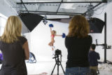 Broncos cheerleader Nicole Moore performs parts of the Broncos routine, suggested by Director of...