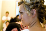 Bronco cheerleader Jamie Dukehart-Conti gets her makeup done while her hair sets for our annual...