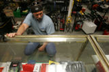 Bill Bassett, of Golden, looks at tools at Pasternack's Pawn Shop in Lakewood, Colo., on Thursday,...