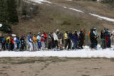 Skiers  wait for a ride on the Ajax Express lift, Friday morning, June 13, 2008, Aspen Mountian....