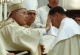 At the ordination Archbishop Chaput anoints Bishop James Conley with oil at Cathedral Basilica of...