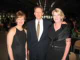 (L-R) Meg Mullen Hogan (V.P. of Fund Development for BBBS) with Brian and Nancy Jackson. (Brian is...