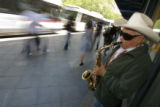 DM0004  Jalberto Guzman plays the saxophone on the 16th Street Mall in Denver, Colo. June 17,...