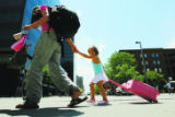 DM0006  Jordan Kerkhoff, 3, of Huntington, Ind. walks down the 16th Street Mall pulling her...