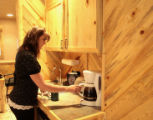 Tiana Hartman gets coffee in the newly redecorated area that used beetle kill pine trees, Mountain...