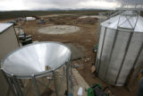 The holding silo for the finished pellets wait to be assembled, Tuesday afternoon, June 3, 2008,...