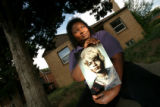 BG0037 A portrait of Dorothy Williams is held by her oldest daughter, Damita Shelton, who recalls...