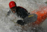 "DM0435  Joe Carberry, 31, plays in a rapid known as the ""C hole"" while kayaking on the..."