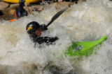 "DM0648  Brian Burger plays in a man-made rapid known as the ""C hole"" while kayaking the..."