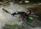 "DM0663  Brian Burger plays in a man-made rapid known as the ""C hole"" while kayaking the..."