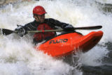 "DM0702  Joe Carberry, 31, plays in a rapid known as the ""C hole"" while kayaking on the..."