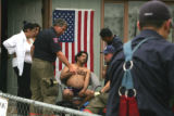 A resident of the Airways Hotel graps his chest in pain after  a late morning fire Wednesday June...