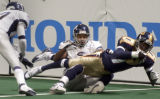 Colorado Crush offensive specialist, Damian Harrell (right #1) dives for a first down in the...
