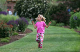 Sarah Dormer (cq), 7, plays at the Denver Botanic Gardens before a Neville Brothers concert in...