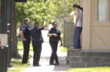 Denver police search the neighborhood near Sandoval elementary school  in Denver, Colo., on...