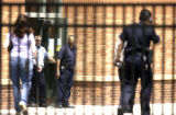 Denver police and school security officers search Sandoval elementary school  in Denver, Colo., on...