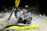 Ian Schwendy (cq), 30, gets a faceful of water while playing in a wave in his kayak Tuesday May...