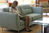 Cathy McNamara (cq), of Denver, spends her lunch break looking at furniture at Bova Furniture,...