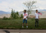 (PG8358) Kris Fahrenbruck (left) and his son, Christian, 14, of Fort Collins, Colo., line the...