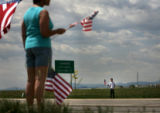 (PG8408) People line the street before the burial of Sgt. Isaac Palomarez, 26, on Monday, May 19,...