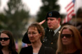 (PG8489) People stand in attendance at the burial of Sgt. Isaac Palomarez, 26, of Loveland, Colo.,...