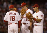 09 May, 2005  Cardinals starting pitcher Mark Mulder consults with catcher Einar Diaz (obscured),...