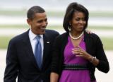 ILCC105 - Democratic presidential hopeful, Sen. Barack Obama D-Ill., boards his plane with his...