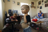 30 year-old Gena Meyer (cq) and her two kids, 5 year-old Toby Meyer (cq), (at left) who is...