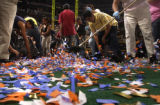 Pepsi center clean up crews take to the field after Confetti was mis-fired before the end of...