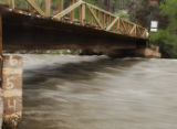 A river guage marks the water level of the Crystal River outside of Carbondale at 4 feet on...