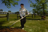 Nettie Moore (cq) works with other members of the Kawinas of Capital City on cleaning a park named...