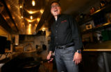 (PG12087)  Noodles & Co. CEO Kevin Reddy laughs while posing for a portrait in the kitchen of...